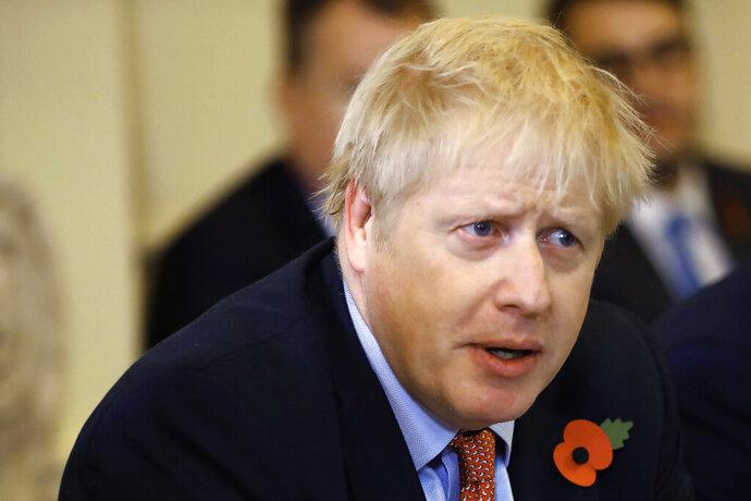 Britain's Prime Minister Boris Johnson speaks during a cabinet meeting, inside number 10 Downing Street, in central London, Tuesday, Nov. 5, 2019. (Tolga Akmen/Pool Photo via AP)