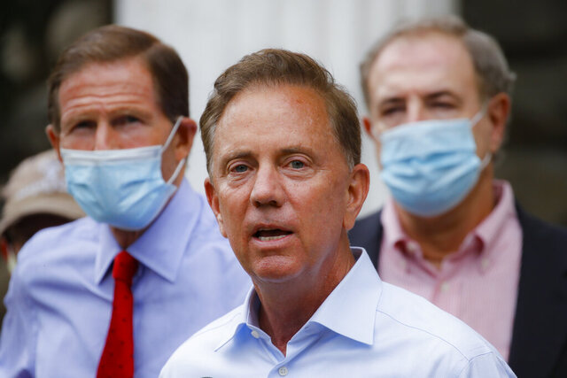 FILE- In this Aug. 7, 2020, file photo, Connecticut Gov. Ned Lamont addresses the media in Westport, Conn. During a coronavirus briefing on Thursday, Aug. 20, 2020, Lamont said the Connecticut Department of Labor will be applying for a federal program that could lead to $300 in additional weekly unemployment benefits for certain recipients who've lost work because of the coronavirus pandemic. (AP Photo/John Minchillo, File)