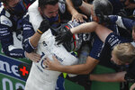 AlfaTauri driver Pierre Gasly of France celebrates winning the Italian Formula One Grand Prix, at the Monza racetrack in Monza, Italy, Sunday Sept. 6, 2020. (AP Photo/Luca Bruno, Pool)