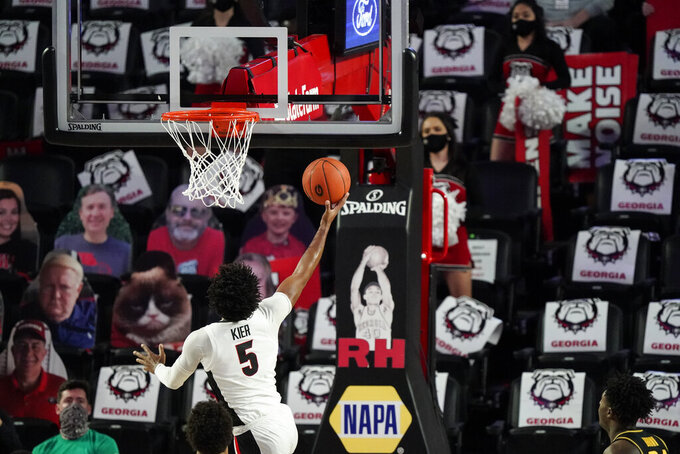 Georgia's Justin Kier (5) shoots during the first half of the team's NCAA college basketball game against Missouri on Tuesday, Feb. 16, 2021, in Athens, Ga. (AP Photo/Brynn Anderson)