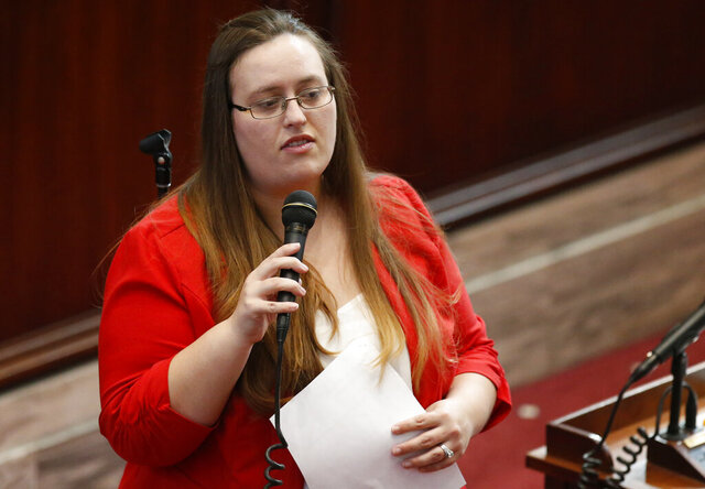 FILE - In this Feb. 1, 2018, file photo, Oklahoma state Dem. Sen. Allison Ikley-Freeman speaks during her swearing-in ceremony in Oklahoma City. Ikley-Freeman has been charged with first-degree manslaughter after authorities say she was speeding when her vehicle skidded off a rain-slickened interstate and crashed into a man whose vehicle was disabled, killing him. (AP Photo/Sue Ogrocki, File)
