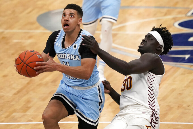 Indiana State's Tyreke Key, left, heads to the basket as Loyola of Chicago's Aher Uguak (30) defends during the first half of an NCAA college basketball game in the semifinal round of the Missouri Valley Conference men's tournament Saturday, March 6, 2021, in St. Louis. (AP Photo/Jeff Roberson)