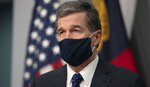 Governor Roy Cooper wears a face covering as he closes his press briefing on the COVID-19 virus at the Emergency Operations Center on Tuesday, July 28, 2020, in Raleigh, N.C. (Robert Willett/The News & Observer via AP)
