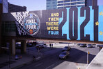 Signage on a crosswalk near the Final Four round of the NCAA tournament at Lucas Oil Stadium in Indianapolis, Saturday, April 3, 2021. (AP Photo/AJ Mast)
