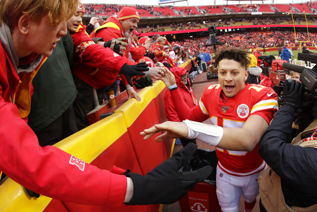 Kansas City Chiefs quarterback Patrick Mahomes (15) celebrates with fans after an NFL football game against the Los Angeles Chargers, Sunday, Dec. 29, 2019, in Kansas City, Mo. (AP Photo/Charlie Riedel)