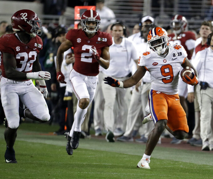Clemson's Travis Etienne runs during the second half of the NCAA college football playoff championship game against Alabama, Monday, Jan. 7, 2019, in Santa Clara, Calif. (AP Photo/Chris Carlson)
