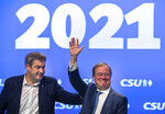 Markus Söder, left, CSU party leader and prime minister of Bavaria, and Armin Laschet, CDU/CSU candidate for chancellor, are on stage together at the CSU party conference in Nuremberg, Germany, Saturday, Sept.11, 2021. It is the first attendance party conference of the CSU since the outbreak of the Corona pandemic. (Peter Kneffel/dpa via AP)
