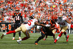 Cincinnati Bengals running back Joe Mixon (28) runs the ball against San Francisco 49ers cornerback Richard Sherman (25) during the first half an NFL football game, Sunday, Sept. 15, 2019, in Cincinnati. (AP Photo/Frank Victores)