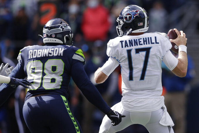 Seattle Seahawks defensive end Alton Robinson (98) moves to hit Tennessee Titans quarterback Ryan Tannehill for a fumble that was recovered by the Seahawks during the first half of an NFL football game, Sunday, Sept. 19, 2021, in Seattle. (AP Photo/John Froschauer)