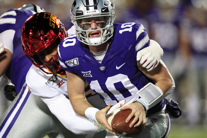 Kansas State quarterback Skylar Thompson (10) is sacked by Iowa State linebacker Will McDonald, left, during the first half of an NCAA college football game in Manhattan, Kan., Saturday, Nov. 30, 2019. (AP Photo/Orlin Wagner)