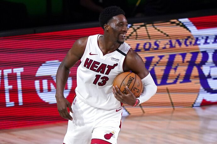 Miami Heat forward Bam Adebayo (13) celebrates after their NBA conference final playoff basketball game against the Boston Celtics on Thursday, Sept. 17, 2020, in Lake Buena Vista, Fla. The Heat won 106-101. (AP Photo/Mark J. Terrill)