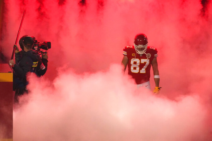 Kansas City Chiefs tight end Travis Kelce runs onto the field before the AFC championship NFL football game against the Buffalo Bills, Sunday, Jan. 24, 2021, in Kansas City, Mo. (AP Photo/Charlie Riedel)