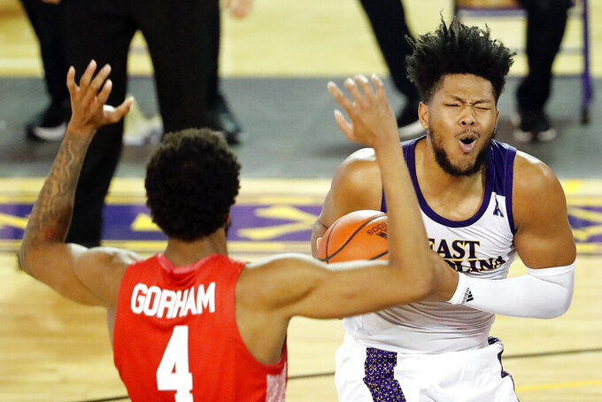 East Carolina's Jayden Gardner (1) grabs a rebound in front of Houston's Justin Gorham (4) during the second half of an NCAA college basketball game in Greenville, N.C., Wednesday, Feb. 3, 2021. (AP Photo/Karl B DeBlaker)