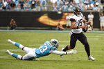 Carolina Panthers linebacker Brian Burns (53) dives for Jacksonville Jaguars quarterback Gardner Minshew (15) during the second half of an NFL football game in Charlotte, N.C., Sunday, Oct. 6, 2019. (AP Photo/Mike McCarn)