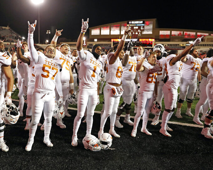 "FILE - In this Nov. 10, 2018, file photo, Texas players sing ""The Eyes of Texas"" after an NCAA college football game against Texas Tech in Lubbock, Texas. The University of Texas announced a series of steps Monday, July 13, 2020 intended to make itself more welcoming to its Black students but stopped short of shelving ""The Eyes of Texas"" song that a number of athletes have said needs to go because it has racist undertones. (AP Photo/Brad Tollefson, File)"