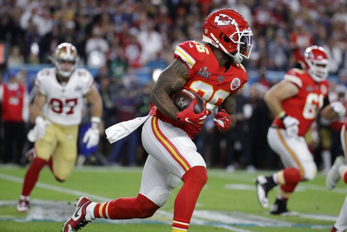 Kansas City Chiefs' Damien Williams (26) runs against the San Francisco 49ers during the first half of the NFL Super Bowl 54 football game Sunday, Feb. 2, 2020, in Miami Gardens, Fla. (AP Photo/Patrick Semansky)