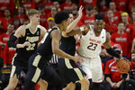 Maryland forward Bruno Fernando, right, drives against Purdue center Matt Haarms, guard Nojel Eastern and forward Grady Eifert, from left, during the first half of an NCAA college basketball game Tuesday, Feb. 12, 2019, in College Park, Md. (AP Photo/Patrick Semansky)