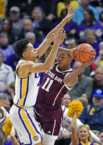 Texas A&M guard Wendell Mitchell, left, is closely guarded by LSU guard Skylar Mays, right, in the first half of an NCAA college basketball game, Tuesday, Feb. 26, 2019, in Baton Rouge, La. (AP Photo/Bill Feig)