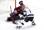 Arizona Coyotes goaltender Adin Hill (31) makes a save on a shot by Los Angeles Kings center Jeff Carter (77) during a shootout of an NHL hockey game Tuesday, March 13, 2018, in Glendale, Ariz. The Coyotes defeated the Kings 4-3. (AP Photo/Ross D. Franklin)