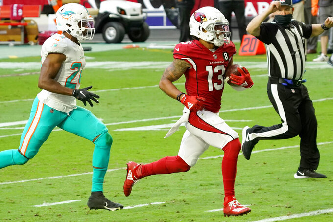 Arizona Cardinals wide receiver Christian Kirk (13) scores a touchdown as Miami Dolphins cornerback Byron Jones (24) pursues during the first half of an NFL football game, Sunday, Nov. 8, 2020, in Glendale, Ariz. (AP Photo/Rick Scuteri)