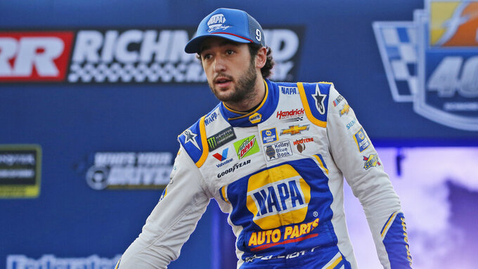 Chase Elliott greets fans during driver introductions for the NASCAR Monster Energy Cup series auto race at Richmond Raceway in Richmond, Va., Saturday, Sept. 21, 2019. (AP Photo/Steve Helber)