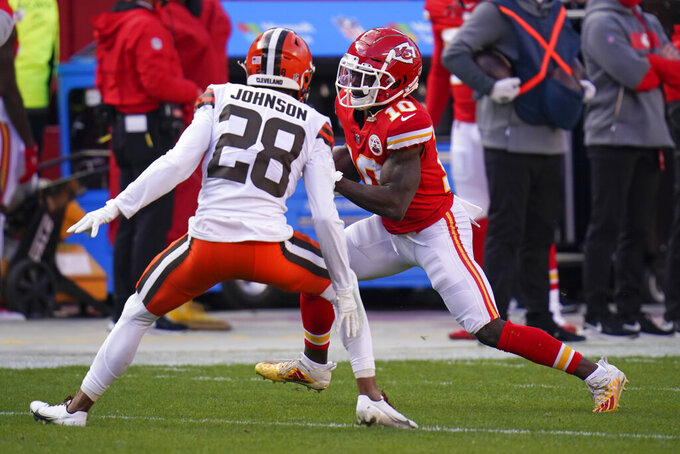 Kansas City Chiefs wide receiver Tyreek Hill (10) runs from Cleveland Browns cornerback Kevin Johnson (28) during the first half of an NFL divisional round football game, Sunday, Jan. 17, 2021, in Kansas City. (AP Photo/Jeff Roberson)
