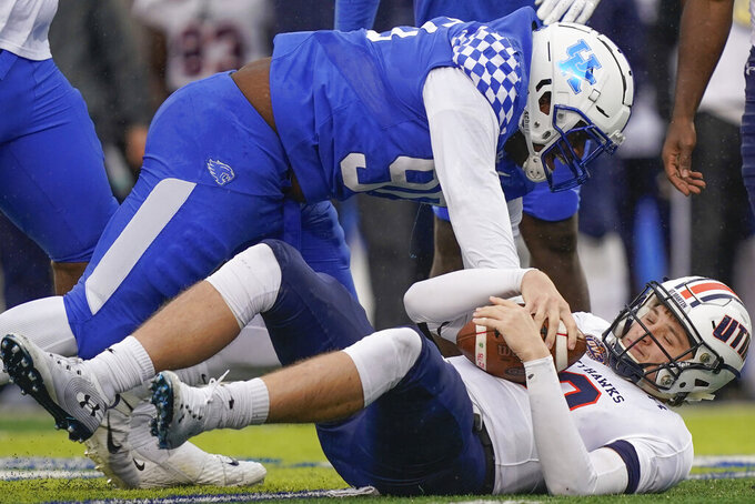 Kentucky defensive end T.J. Carter (90) sacks UT Martin quarterback John Bachus III (18) during the first half on an NCAA college football game, Saturday, Nov. 23, 2019, in Lexington, Ky. (AP Photo/Bryan Woolston)
