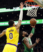Boston Celtics guard Kyrie Irving (11) goes to the hoop against Los Angeles Lakers forward Kyle Kuzma (0) in the first quarter of an NBA basketball game, Thursday, Feb. 7, 2019, in Boston. (AP Photo/Elise Amendola)