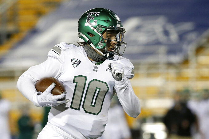 FILE- In this Nov. 4, 2020, file photo, Eastern Michigan Eagles quarterback Preston Hutchinson (10) carries the ball during an NCAA football game against the Kent State in Kent, Ohio. Wisconsin will try to bounce back from its season-opening loss to Penn State by ending Eastern Michigan's uncanny recent run of success against Big Ten teams. (AP Photo/Kirk Irwin, File)