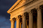 FILE - In this Oct. 10, 2017, file photo, the Supreme Court in Washington is seen at sunset.  The Supreme Court announced Aug. 23, 2019, that says Justice Ruth Bader Ginsburg has completed radiation therapy for a tumor on her pancreas and there is no evidence of the disease remaining.. (AP Photo/J. Scott Applewhite, File)
