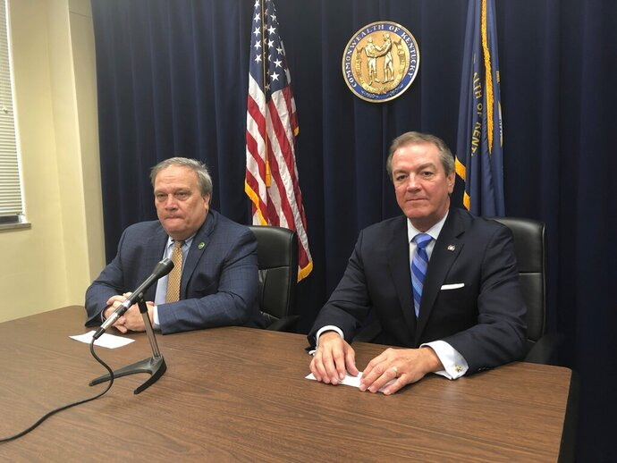 Kentucky Republican Senate President Robert Stivers, left, and Republican House Speaker David Osborne speak with reporters about appointing a pension working group, Friday, Jan. 11, 2019, in Frankfort, Ky. (AP Photo/Adam Beam)