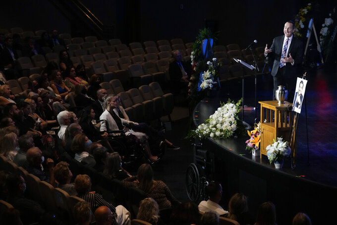 Pastor Don Robson speaks to mourners during a funeral service for Edgar Gonzalez, who was killed last month in the Champlain Towers South condominium collapse, on Friday, July 23, 2021, in Palmetto Bay, Fla. (AP Photo/Rebecca Blackwell)