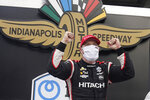 Josef Newgarden celebrates after winning an IndyCar auto race at Indianapolis Motor Speedway, Friday, Oct. 2, 2020, in Indianapolis. (AP Photo/Darron Cummings)