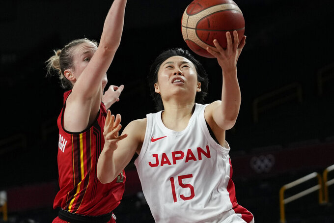Japan's Nako Motohashi (15) drives to the basket against Belgium's Kim Mestdagh (5) during a women's basketball quarterfinal game at the 2020 Summer Olympics, Wednesday, Aug. 4, 2021, in Saitama, Japan. (AP Photo/Eric Gay)