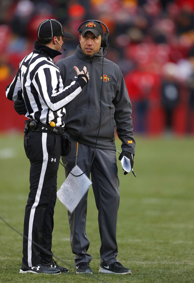 Iowa State head coach Matt Campbell, right, talks with an official after a flag was thrown during the first half of an NCAA college football game against Baylor, Saturday, Nov. 10, 2018, in Ames, Iowa. (AP Photo/Matthew Putney)