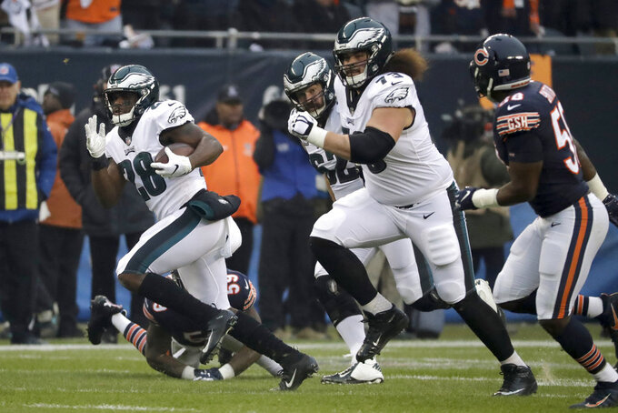 Philadelphia Eagles running back Wendell Smallwood (28) rushes for yardage during the first half of an NFL wild-card playoff football game against the Chicago Bears Sunday, Jan. 6, 2019, in Chicago. (AP Photo/Nam Y. Huh)