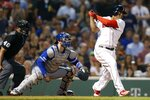 Boston Red Sox's Rafael Devers, right, follows through on his two-run single in front of Toronto Blue Jays catcher Danny Jansen, center, during the third inning of a baseball game in Boston, Monday, July 15, 2019. (AP Photo/Michael Dwyer)