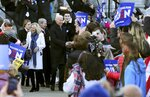 Democratic presidential candidate former Vice President Joe Biden, center, and wife Jill Biden at his side, greet supporters outside the New Hampshire State House after he filed to have his name listed on the New Hampshire primary ballot, Friday, Nov. 8, 2019, in Concord, N.H. (AP Photo/Charles Krupa)
