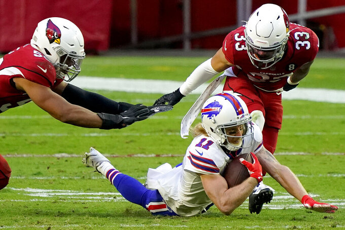 Buffalo Bills wide receiver Cole Beasley (11) dives for extra yards as Arizona Cardinals cornerback Byron Murphy (33) defends during the second half of an NFL football game, Sunday, Nov. 15, 2020, in Glendale, Ariz. (AP Photo/Rick Scuteri)