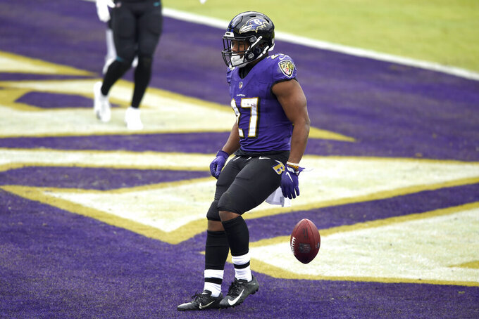 Baltimore Ravens running back J.K. Dobbins reacts after scoring a touchdown run against the Jacksonville Jaguars during the first half of an NFL football game, Sunday, Dec. 20, 2020, in Baltimore. (AP Photo/Gail Burton)