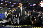 Auburn head coach Bruce Pearl arrives on court during a practice session for the semifinals of the Final Four NCAA college basketball tournament, Friday, April 5, 2019, in Minneapolis. (AP Photo/Charlie Neibergall)
