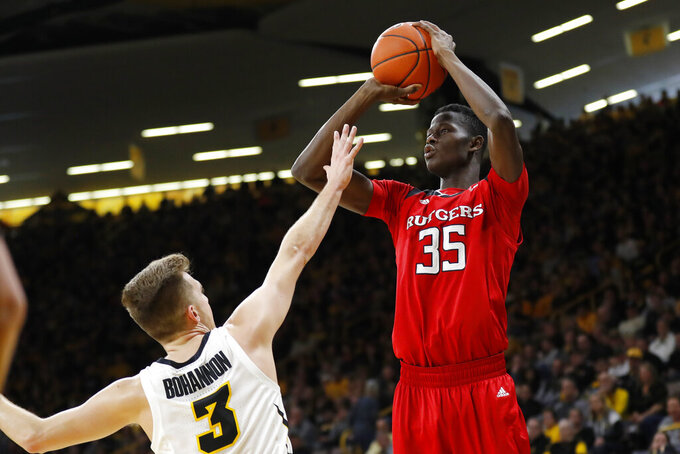 Rutgers forward Issa Thiam (35) shoots a 3-point basket over Iowa guard Jordan Bohannon during the first half of an NCAA college basketball game, Saturday, March 2, 2019, in Iowa City, Iowa. (AP Photo/Charlie Neibergall)