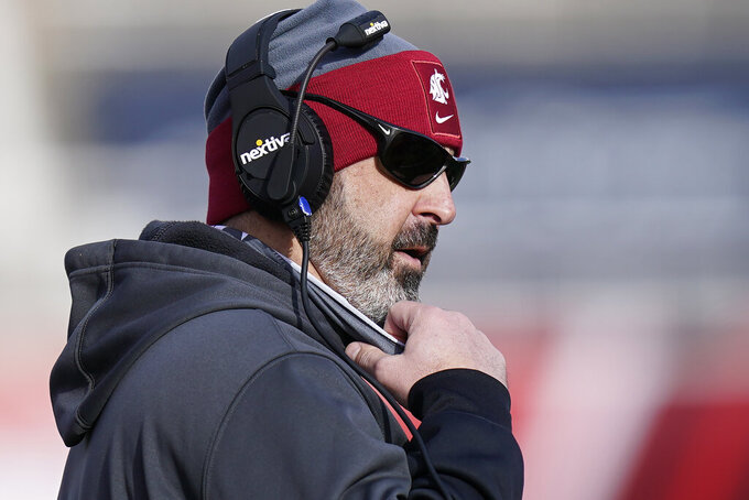 Washington State head coach Nick Rolovich looks on during the first half of an NCAA college football game against Utah, Saturday, Dec. 19, 2020, in Salt Lake City. (AP Photo/Rick Bowmer)