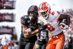 Clemson wide receiver Justyn Ross (8) comes down with a reception against South Carolina defensive back Israel Mukuamu (24) during the first half of an NCAA college football game Saturday, Nov. 30, 2019, in Columbia, S.C. (AP Photo/Sean Rayford)