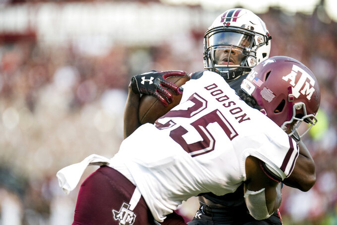 South Carolina wide receiver Bryan Edwards is tackled by Texas A&M linebacker Tyrel Dodson (25) during the second half of an NCAA college football game Saturday, Oct. 13, 2018, in Columbia, S.C. Texas A&M defeated South Carolina 26-23. (AP Photo/Sean Rayford)