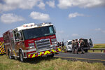 Department of Public Safety troopers inspect the passenger van involved in a three-vehicle crash on Saturday, July 20, 2019, on U.S. 59. Multiple people traveling in the passenger van were pronounced dead at the scene of the crash. Seven people total were injured. (Shelby Miller/The Victoria Advocate via AP)