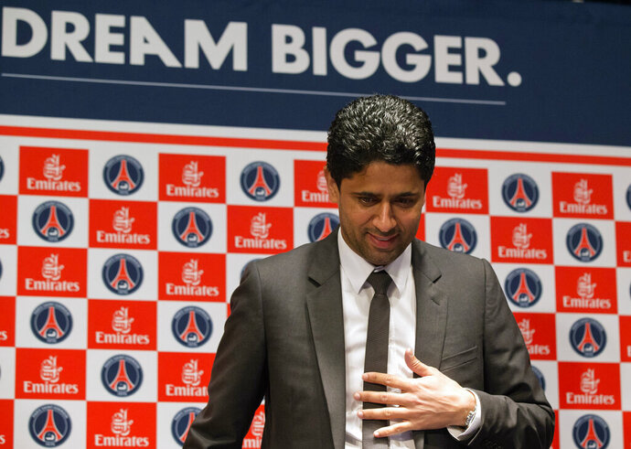 FILE - In this May 17, 2013 file photo, Paris Saint-Germain soccer club President Nasser Al-Khelaifi, arrives to speak to the media during a press conference at Parc des Princes stadium in Paris. A French judicial official says Al-Khelaifi has been placed under investigation for suspected corruption. (AP Photo/Michel Euler, File)