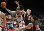 Stanford guard Bryce Wills, left, shoots next to Utah guard Parker Van Dyke (5) and forward Timmy Allen (20) during the second half of an NCAA college basketball game in Stanford, Calif., Thursday, Jan. 24, 2019. (AP Photo/Jeff Chiu)