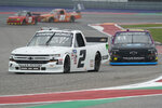 Sheldon Creed (2) leads Tyler Ankrum (26) into Turn 13 during the NASCAR Truck Series auto race at the Circuit of the Americas in Austin, Texas, Saturday, May 22, 2021. (AP Photo/Chuck Burton)