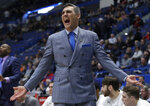 FILE - In this March 21, 2019, file photo, Villanova head coach Jay Wright reacts from the bench during the first half of a first round men's college basketball game against St. Mary's in the NCAA Tournament in Hartford, Conn.  Villanova students are headed back to school this week _ while the Villanova men's basketball coach will be halfway around the world for the next month or so. It has been, and will continue being, a major schedule challenge for Wright as he's tasked with both helping USA Basketball win a gold medal while his college players are on campus getting ready to start their seasons.(AP Photo/Elise Amendola, File)